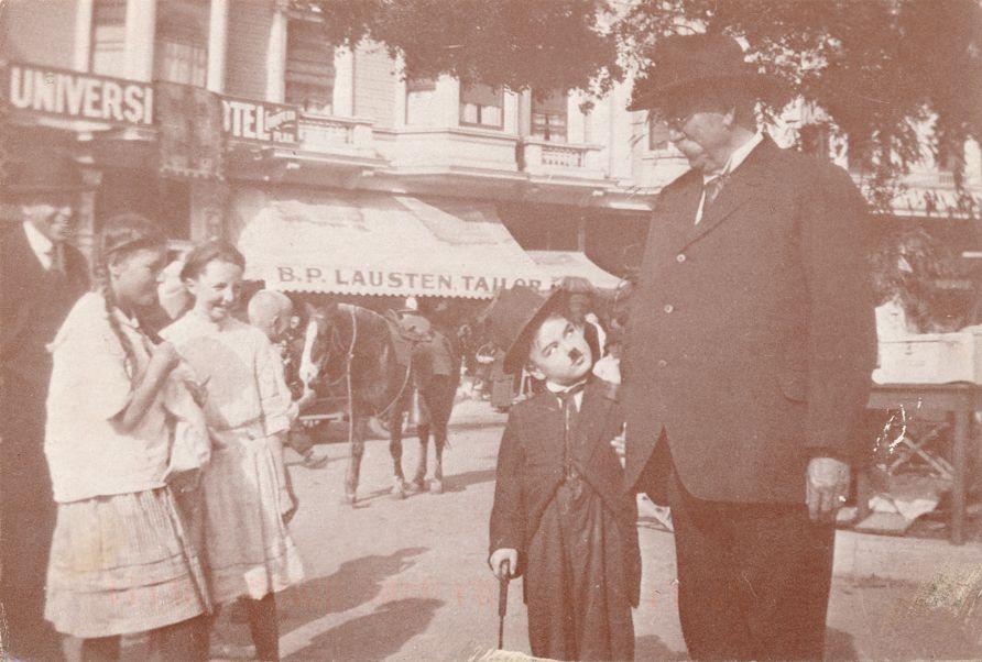 Belgium - Charlie Chaplin visiting Belgian Market - circa 1915 - pm 1998 at San Francisco