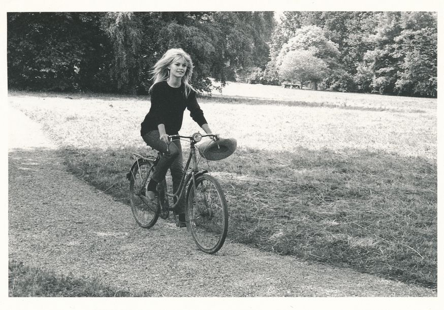 Brigette Bardot riding Bicycle - French Actress, Fashion Model, Animal Rights Activist